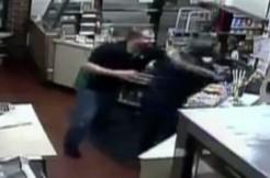 Clerk fights gunman, via screengrab