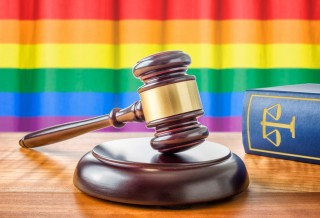 Image of gavel and rainbow flag via Shutterstock