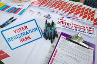 Image of voter registration forms via Joseph Sohm/Shutterstock