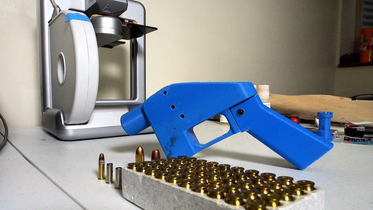 A Liberator pistol appears on July 11, 2013 next to the 3D printer on which its components were made. The single-shot handgun is the first firearm that can be made entirely with plastic components forged with a 3D printer and computer-aided design (CAD) files downloaded from the Internet.