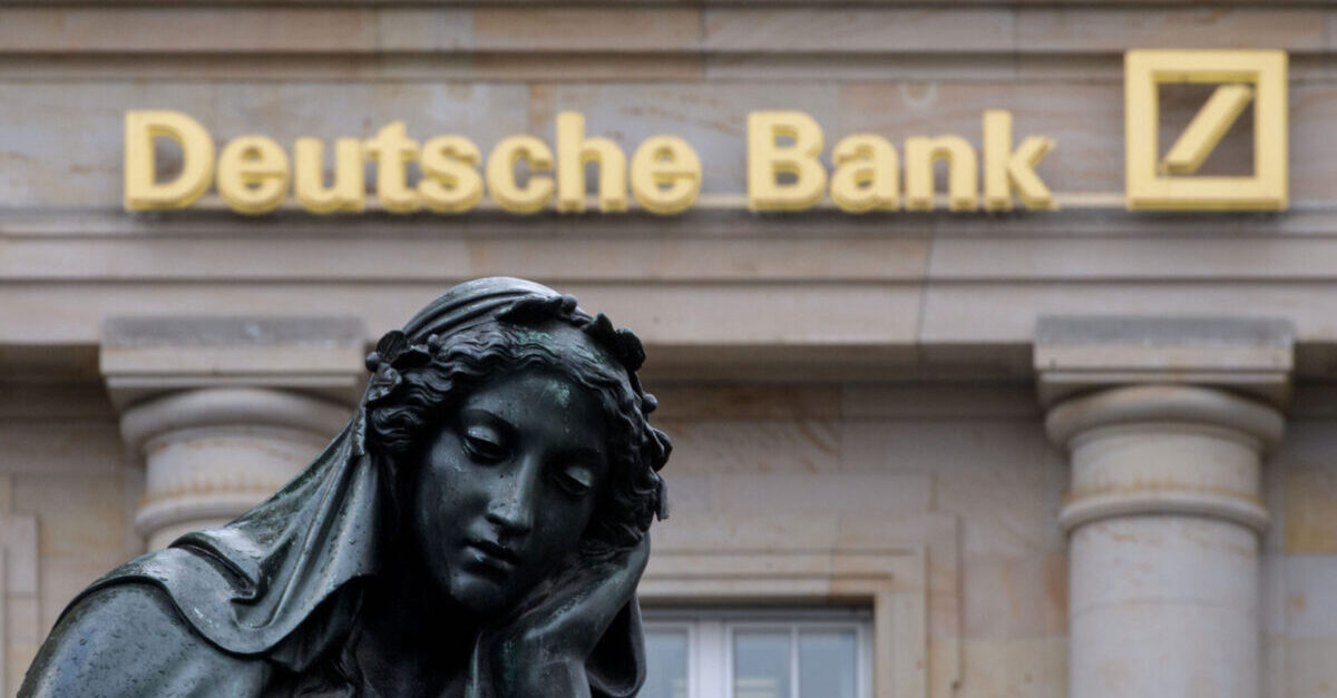 FRANKFURT AM MAIN, GERMANY - FEBRUARY 01: A branch of the German bank Deutsche Bank pictured with a sculpture of the 'Gutenberg' monument on February 1, 2018 in Frankfurt, Germany. Deutsche Bank will announce financial results for 2017 tomorrow. CEO John Cryan has reportedly said the bank had its third straight year of losses but that it will continue on the restructuring course he is leading.