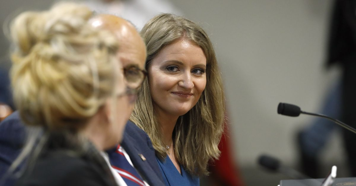 Lawyer Jenna Ellis listens to Melissa Carone who was working for Dominion Voting Services as she speaks in front of the Michigan House Oversight Committee in Lansing Michigan