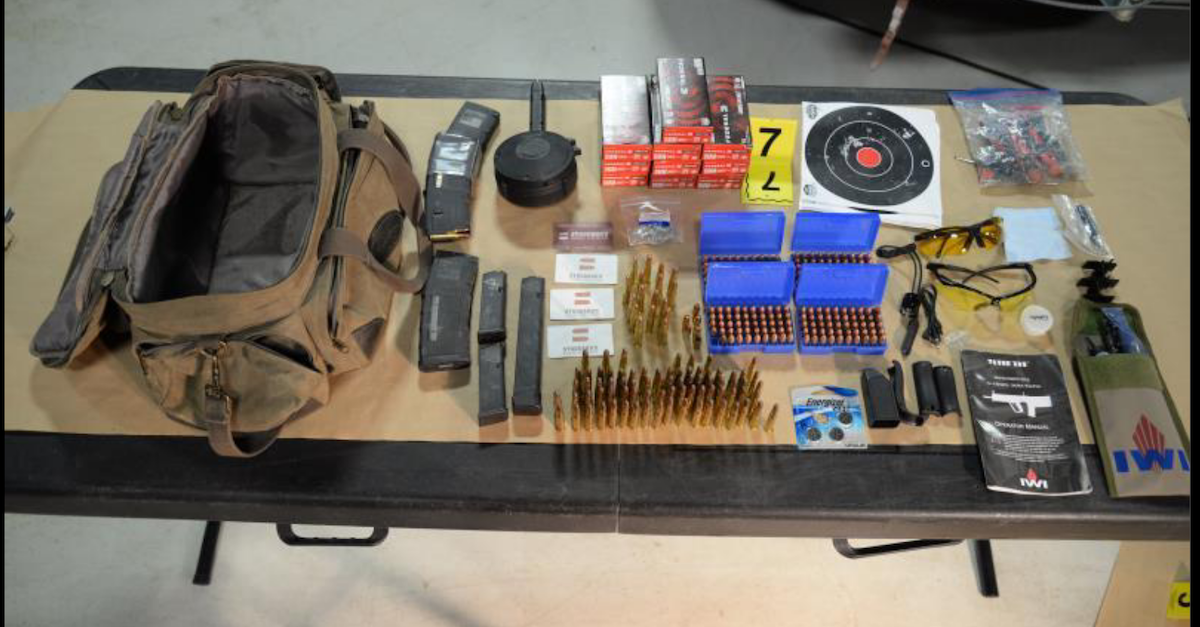 Guns and ammunition obtained by the FBI on a table