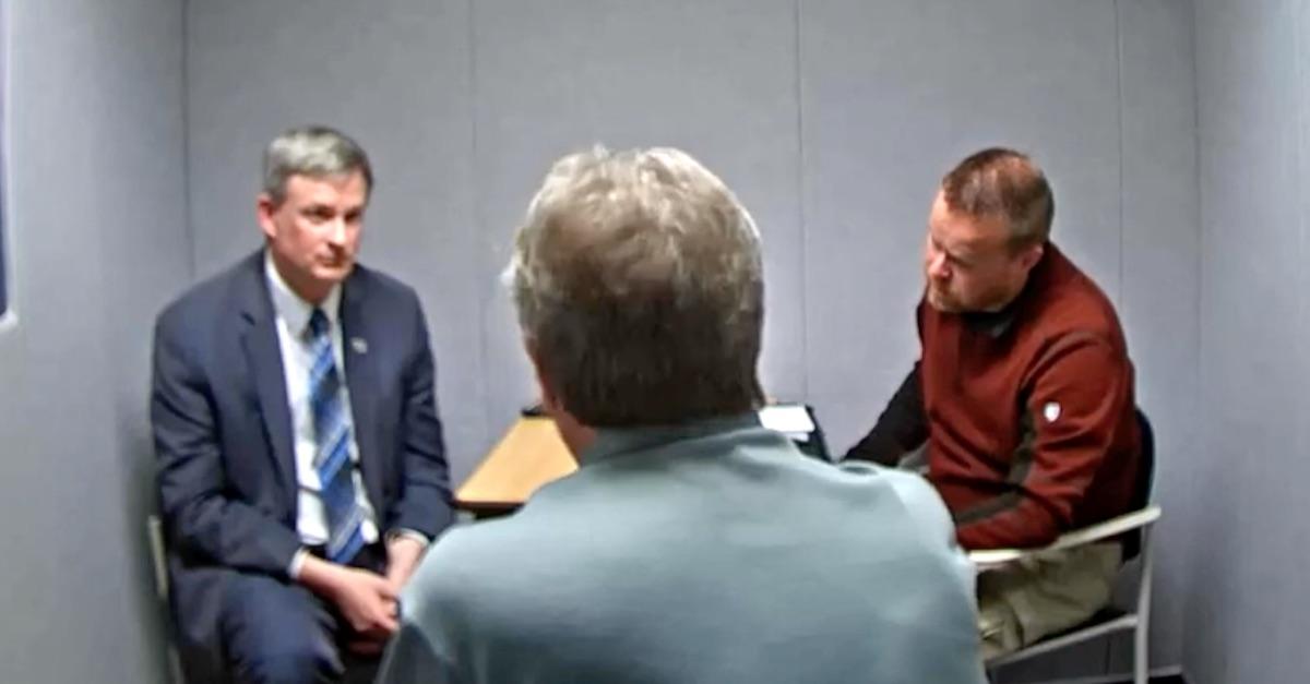 A still frame shows Jason Ravnsborg's interrogation video.