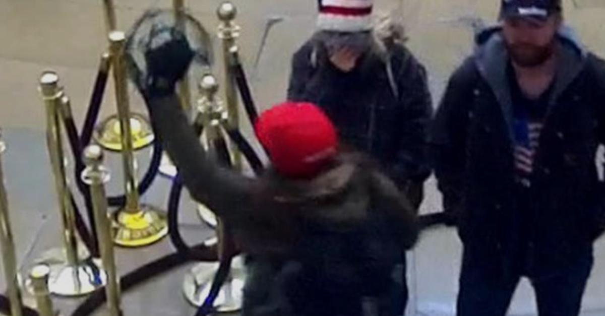 Sara Carpenter plays the tambourine while inside the U.S. Capitol on Jan. 6.