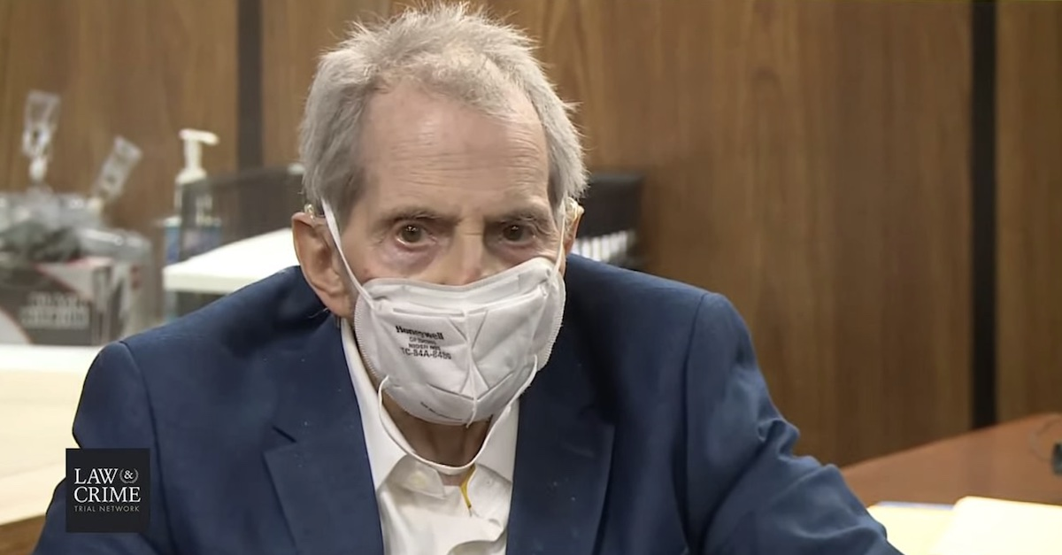 A masked Robert Durst appears in court on May 20, 2021