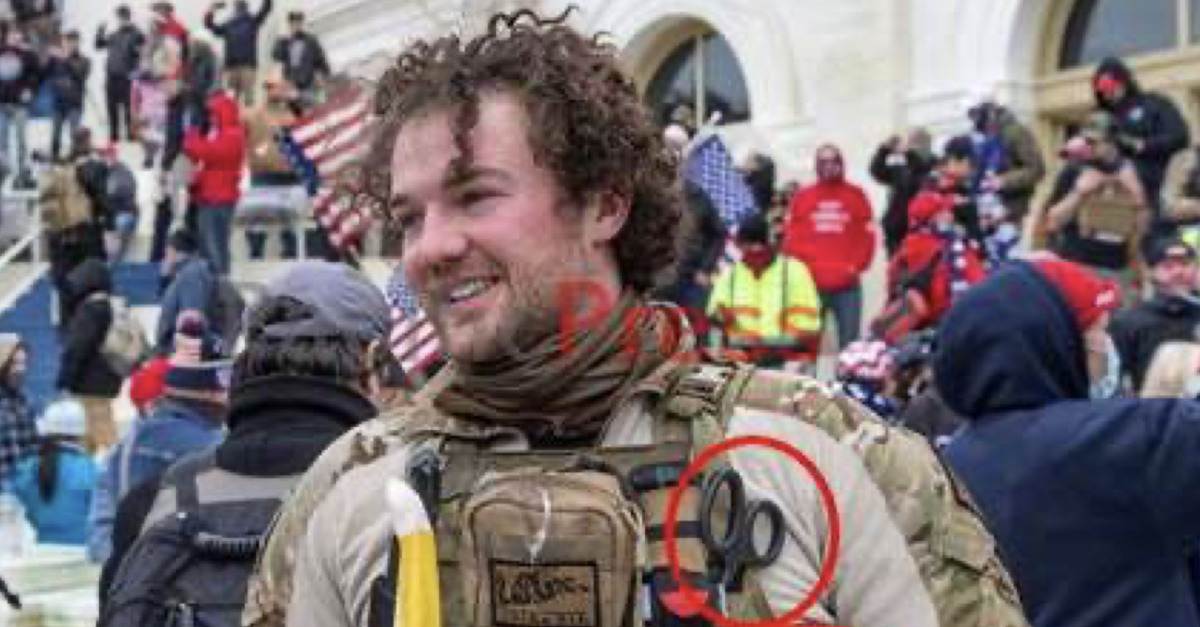 Robert Morss appears in tactical camouflage in front of the U.S. Capitol