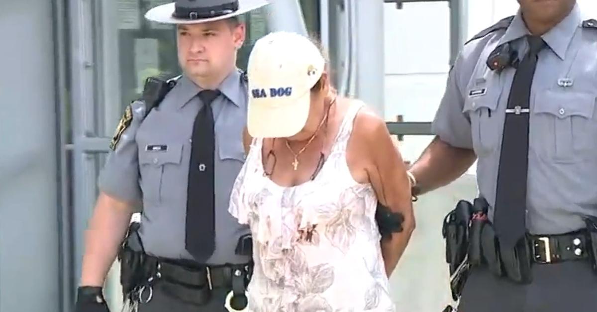 Jacquelyn Walker in handcuffs.