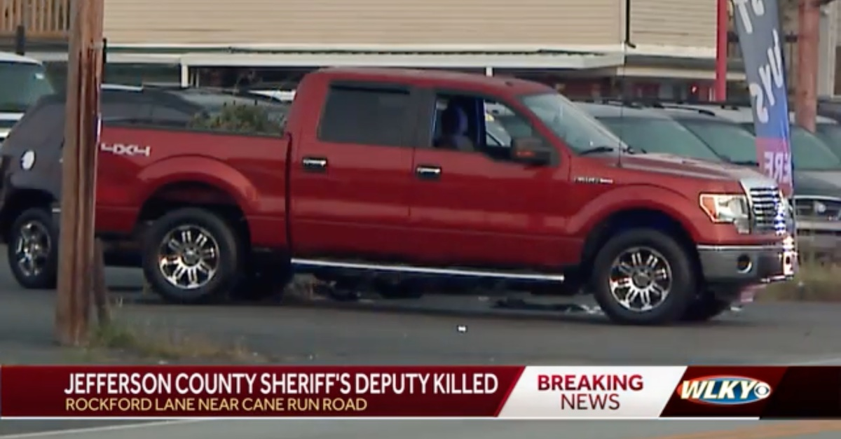 A WLKY-TV screengrab shows evidence tags surrounding a red truck — presumably that owned by Brandon Darby.