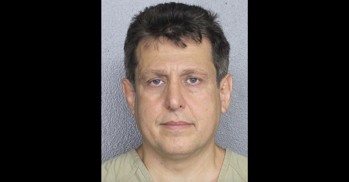 Dan Bauman appears in a mugshot
