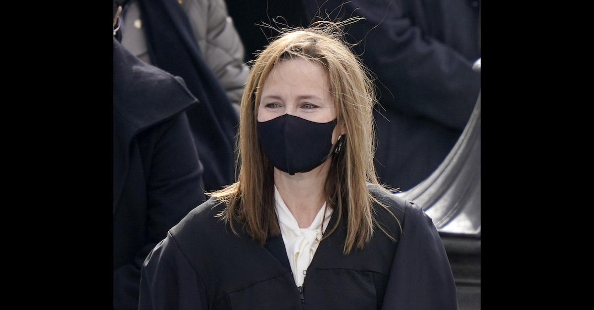 U.S. Supreme Court Justice Amy Coney Barrett is seen wearing a mask in a Jan. 2020 file photo in Washington, D.C.