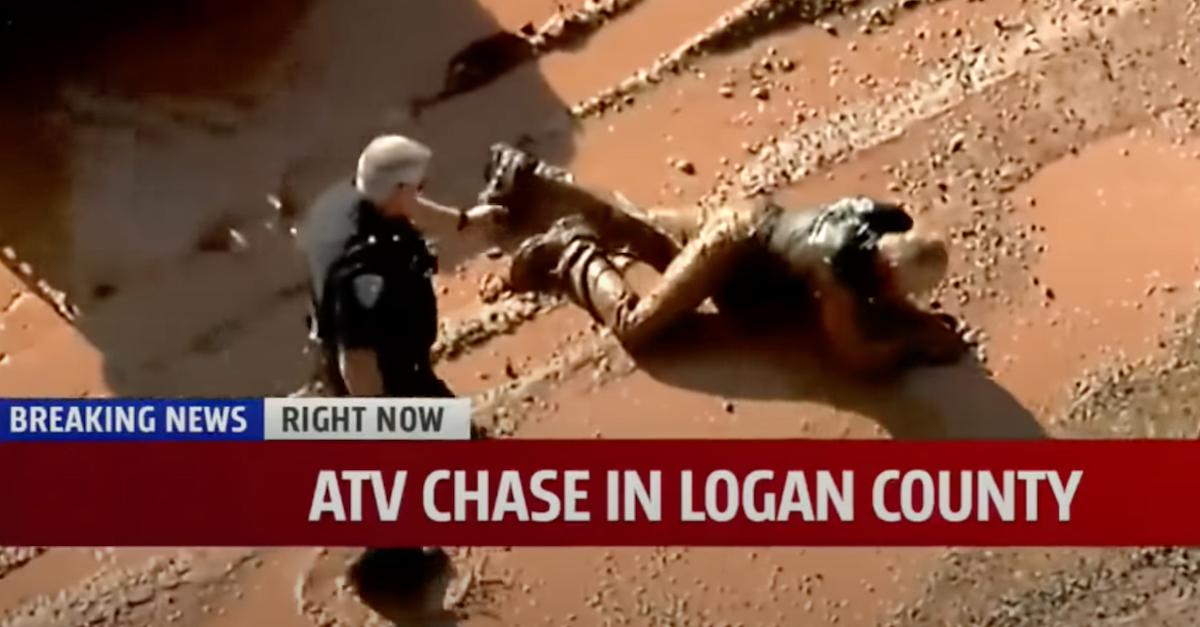 A KFOR-TV screengrab shows Lucas Strider being arrested after crashing an allegedly stolen ATV into a mud puddle.