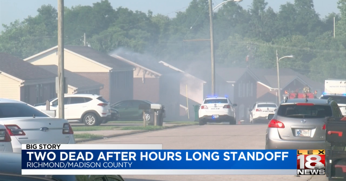 A screengrab from WLEX-TV shows a smoky scene after the suspect allegedly set fire to the property recently purchased by the victims.