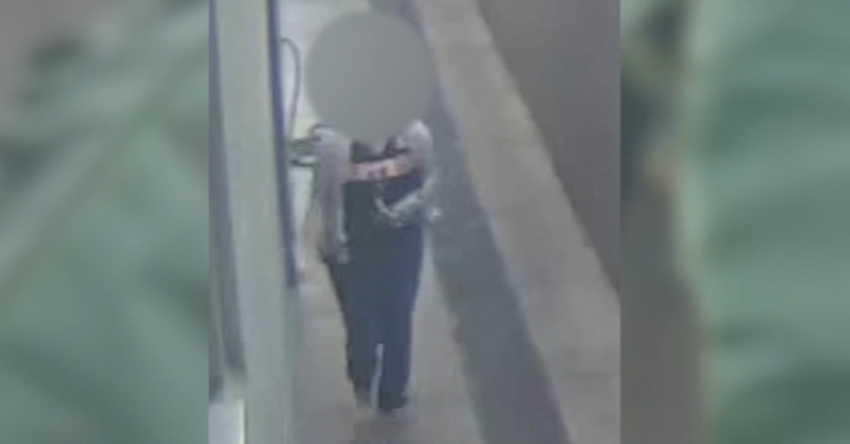 Surveillance footage of woman identified as Tiffany Peteet. Her face is blurred out.