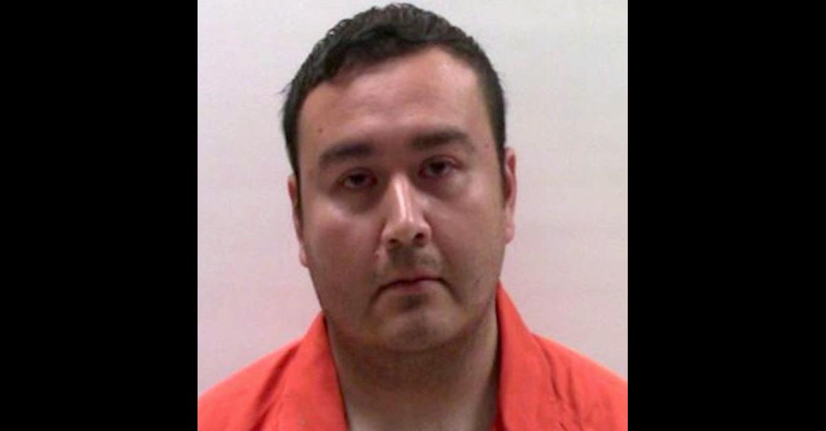 Former Primera, Tex. Police Department police officer Joel Alex Sandate appears in a jail mugshot.