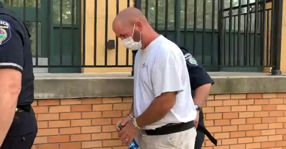 Scott R. Williams in handcuffs.