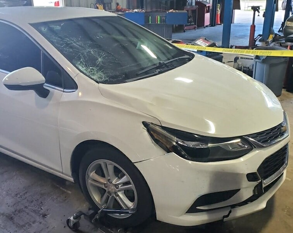 An image released by the Fort Pierce, Fla. Police Department shows the vehicle suspected to have struck and killed Yaceny Berenice Rodriguez-Gonzalez. The passenger headlight area of the car, the passenger side of the front hood, and the passenger windshield all contain noticeable damage.