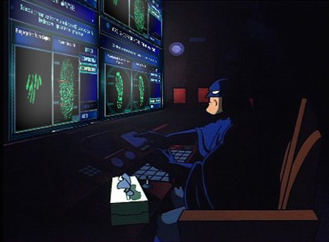 Batman uses the batcomputer in Batman: The Animated Series.