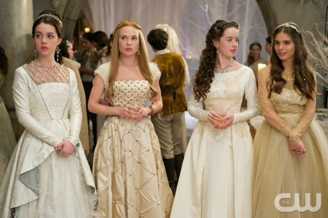 """Reign -- """"Banished"""" -- Image Number: RE212a_0095.jpg -- Pictured (L-R): Adelaide Kane as Mary, Queen of Scotland and France, Celina Sinden as Greer, Anna Popplewell as Lola and Caitlin Stasey as Kenna -- Photo: Sven Frenzel/The CW -- © 2014 The CW Network, LLC. All rights reserved."""