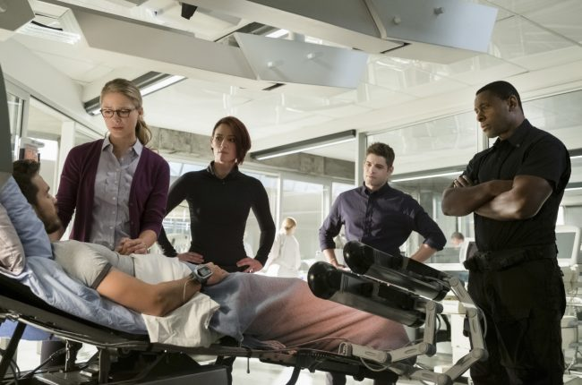 "image: Michael Courtney/The CW Supergirl -- ""Wake Up"" Pictured (L-R): Chris Wood as Mike/Mon-El, Melissa Benoist as Kara, Chyler Leigh as Alex Danvers, Jeremy Jordan as Winn Schott, and David Harewood as Hank Henshaw © 2017 The CW Network, LLC. All Rights Reserved"