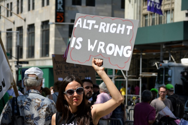 People holding signs supporting Islam to protest a march against Sharia in Lower Manhattan in 2017.