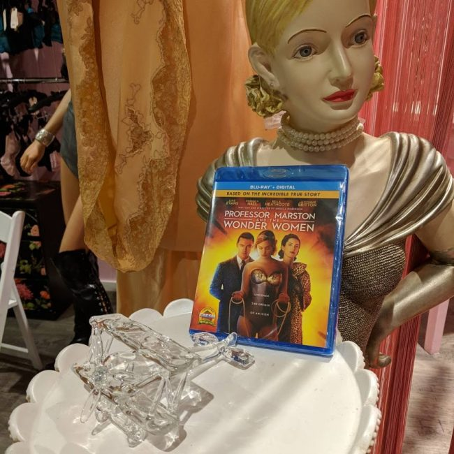 """image: Teresa Jusino The """"Professor Marston and the Wonder Women"""" Blu-ray along with the prop """"invisible plane"""" toy from the film."""