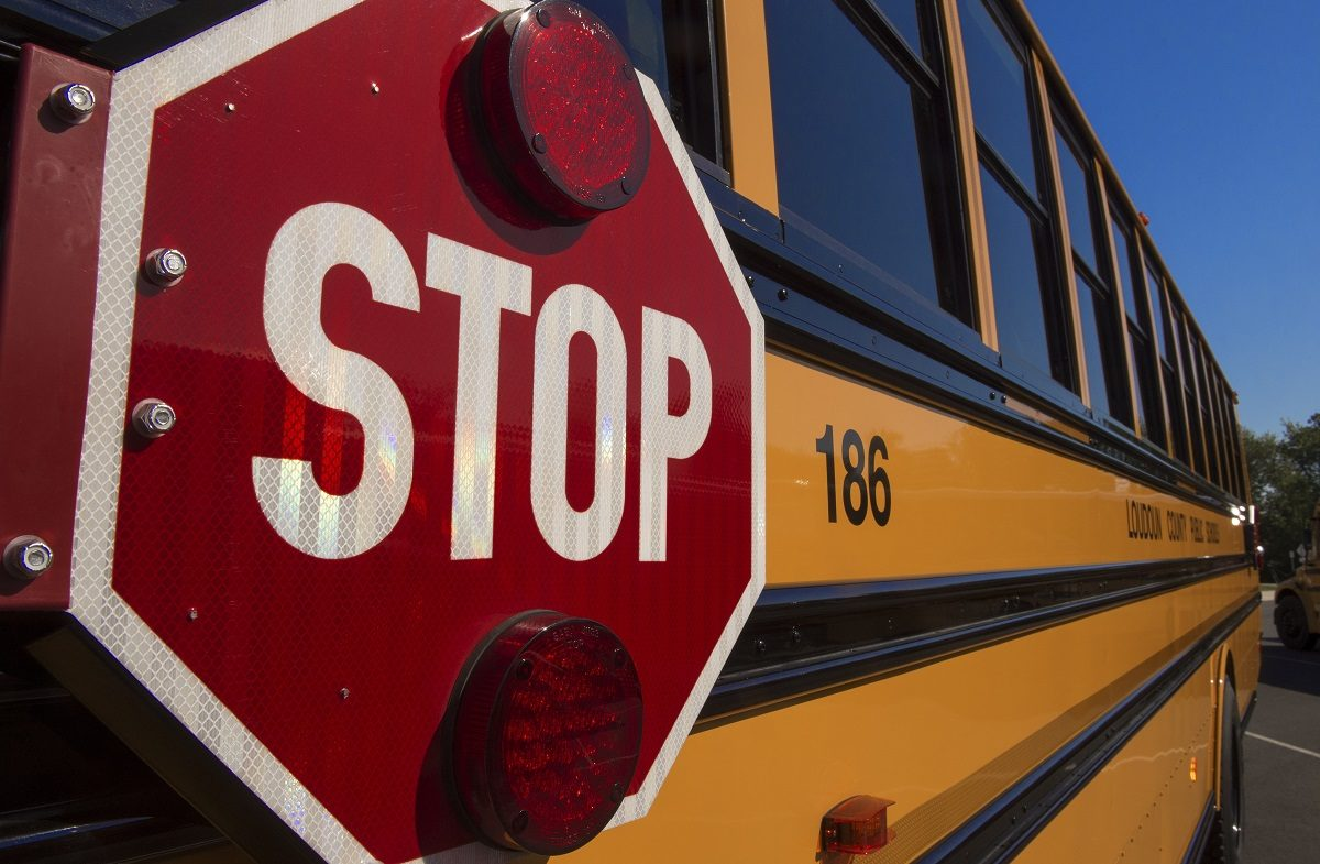 A school bus with a stop sign (Photo credit should read PAUL J. RICHARDS/AFP/Getty Images)