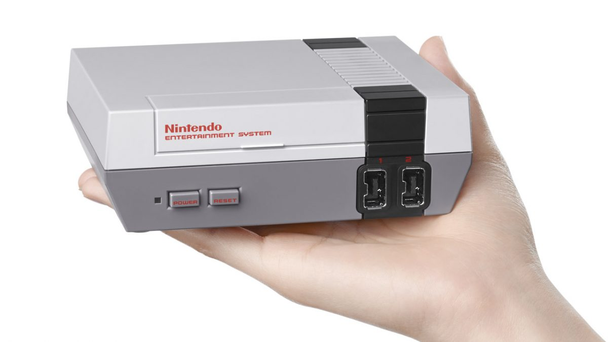 nes classic edition in the palm of a hand