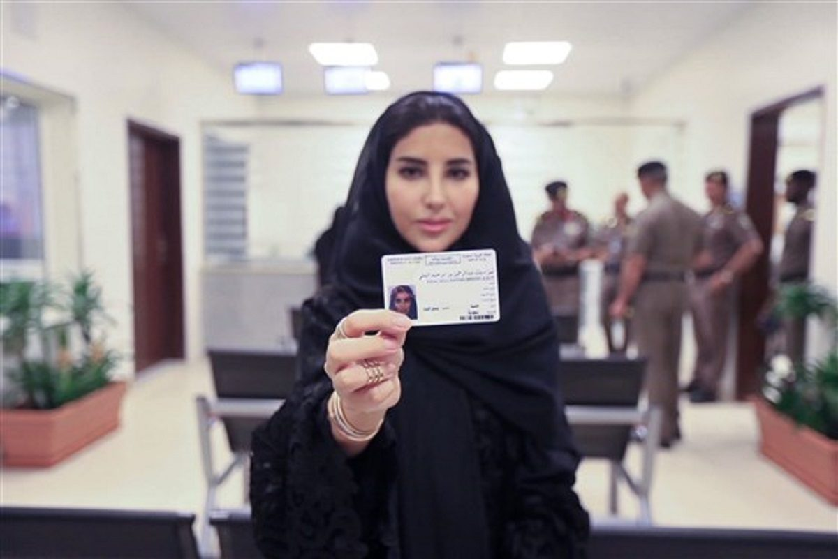 Esraa Albuti displays her new driving license in Riyadh, Saudi Arabia