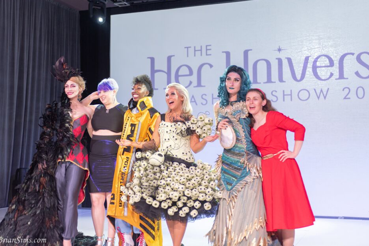 The winners of the 2018 Her Universe Fashion Show pose with Ashley Eckstein in this photo by Brian Sims