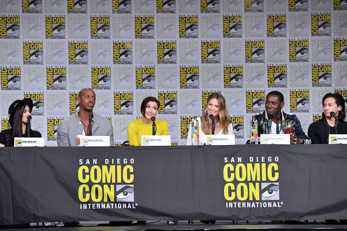 "Katie McGrath, Mehcad Brooks, Chyler Leigh, Melissa Benoist, David Harewood, and Jesse Rath speak onstage at the ""Supergirl"" Special Video Presentation and Q&A during Comic-Con International 2018 at San Diego Convention Center on July 21, 2018 in San Diego, California. (Photo by Mike Coppola/Getty Images)"