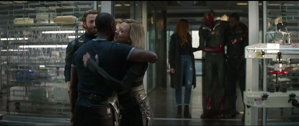 black widow and War Machine hug