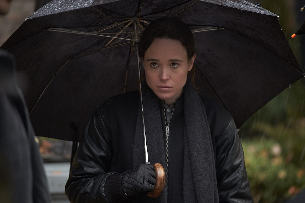 Ellen Page holding an umbrella and looking glum in Netflix's Umbrella Academy.