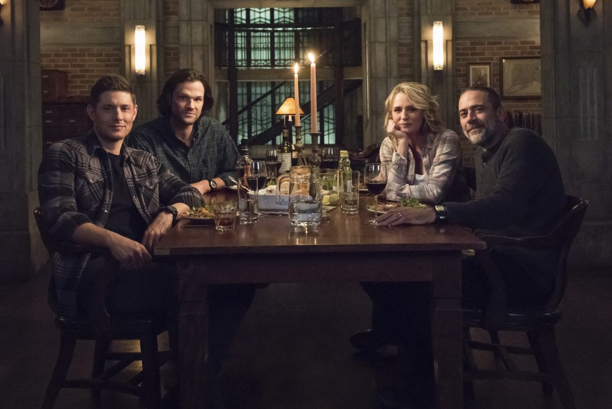 The whole Winchester family around a dinner table in Supernatural.