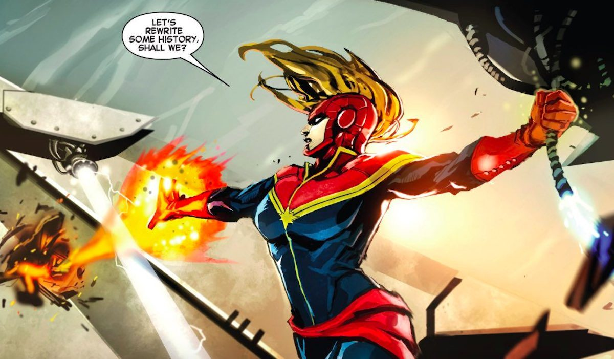 Captain Marvel firing energy blasts and talking about changing history in the comics.