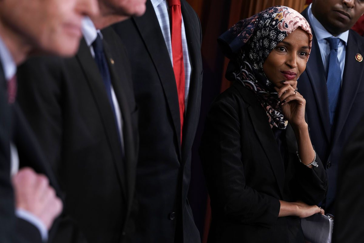 U.S. Rep. Ilhan Omar (D-MN) listens during a news conference.