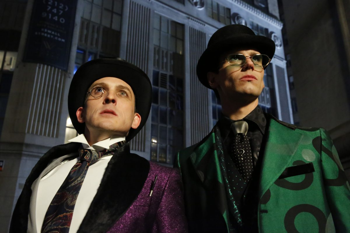 """GOTHAM: L-R: Robin Lord Taylor and Cory Michael Smith in the """"The Beginning..."""" series finale episode of GOTHAM."""