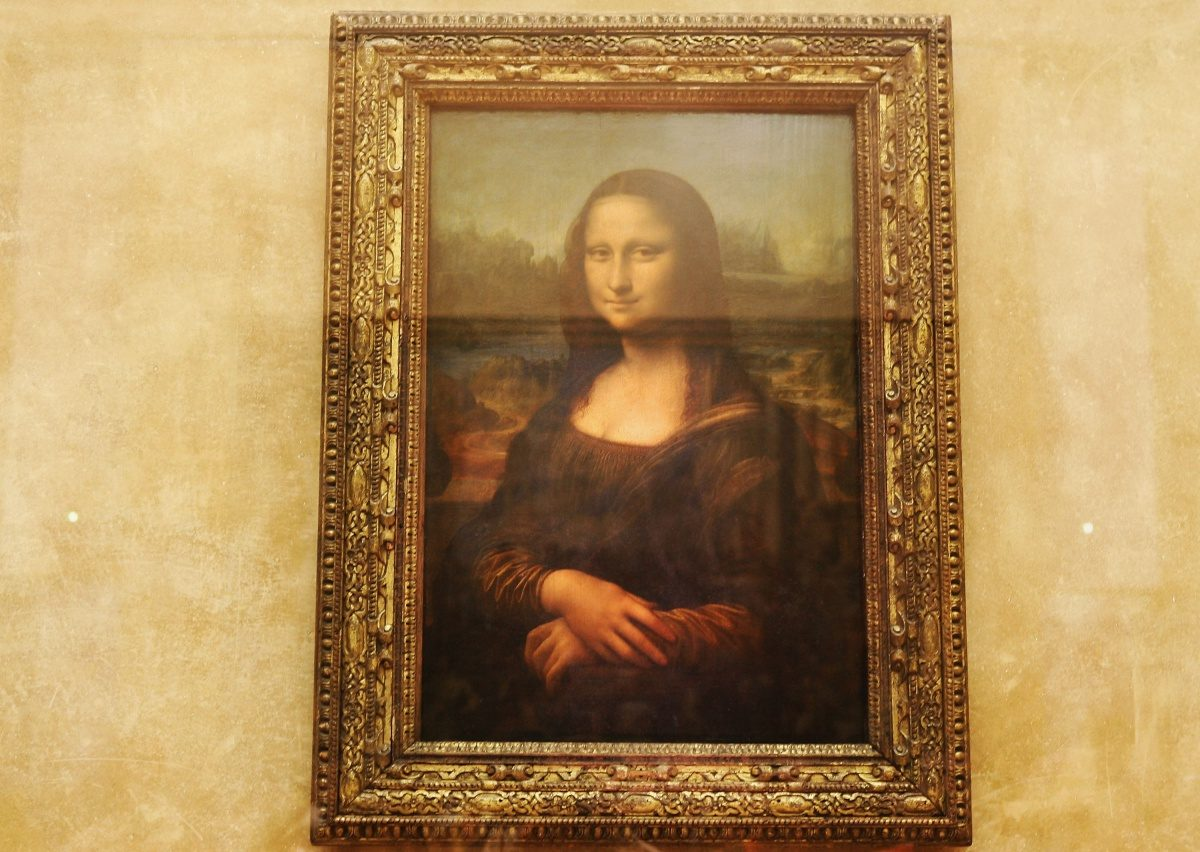 The famous Leonardo Da Vinci painting ' The Mona Lisa' is seen on display in the Grande Galerie of the Louvre museum on August 24, 2005 in Paris, France. Dan Brown is the author of numerous bestsellers, including Digital Fortress, Angels and Demons, and Deception Point. His acclaimed novel 'The Da Vinci Code'has become one of the most widely read books of all time. (Photo by Pascal Le Segretain/Getty Images)
