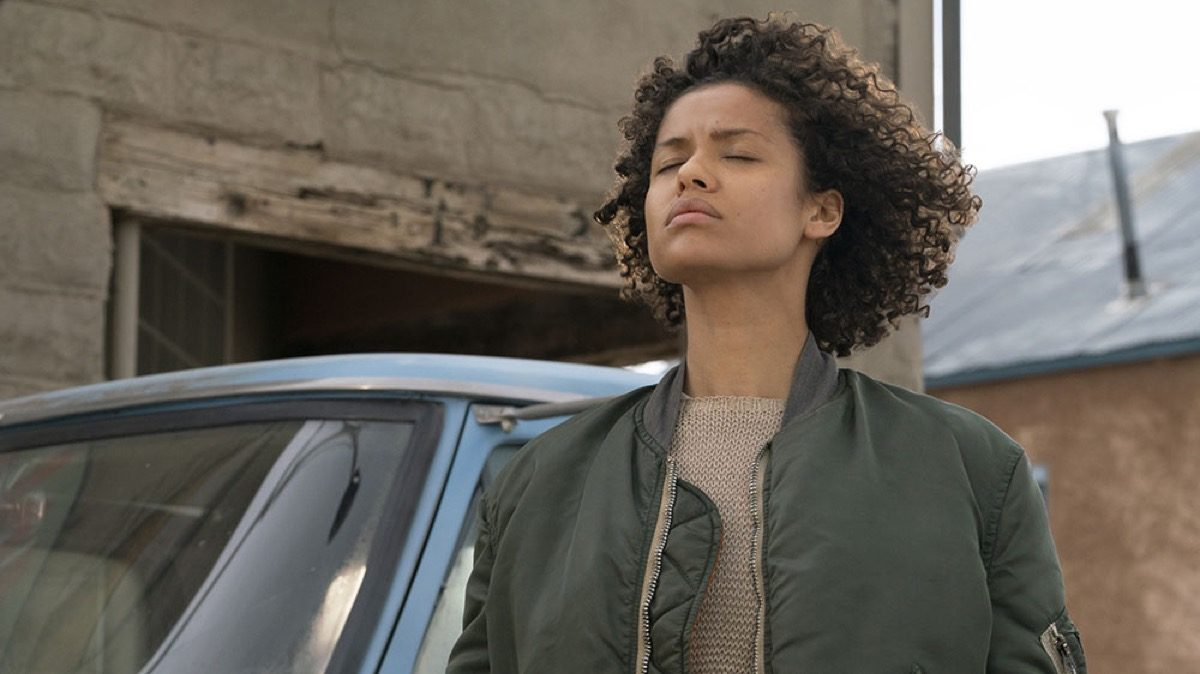Fast color movie still. Ruth standing with her eyes closed.