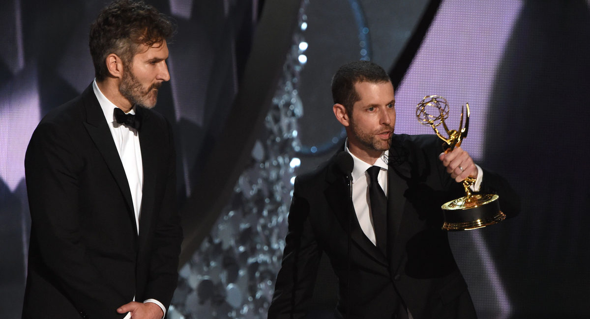 """Writer/producers David Benioff (L) and D.B. Weiss accept the Outstanding Writing for a Drama Series for """"Game of Thrones"""" episode Battle of the Bastards during the 68th Emmy Awards show on September 18, 2016 at the Microsoft Theatre in downtown Los Angeles. / AFP / Valerie MACON (Photo credit should read VALERIE MACON/AFP/Getty Images)"""