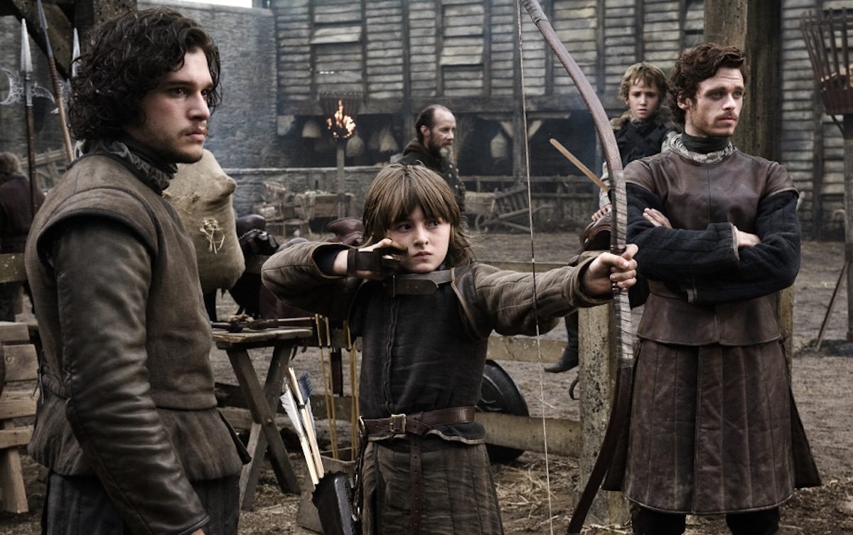 Bran and Robb Stark with Jon Snow in Game of Thrones