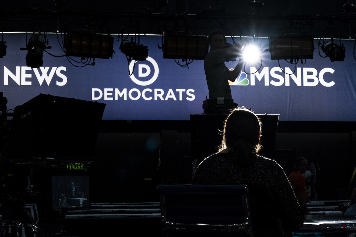 Workers set up a television set for the first Democratic primary debates.