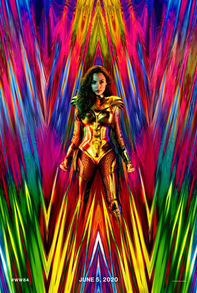 Wonder Woman 1984 poster shows Wonder Woman in a suit of armor against a spiky, rainbow-colored backdrop that looks like WW.