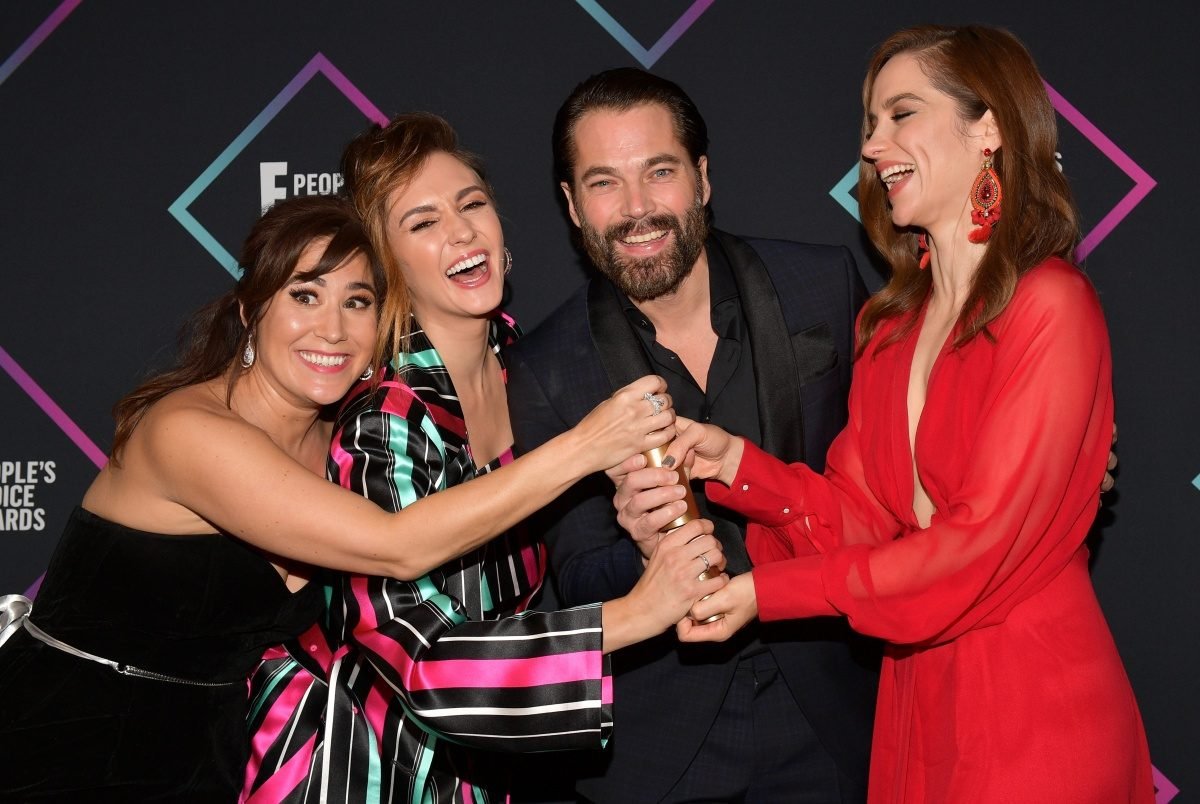 (L-R) Emily Andras, Katherine Barrell, Tim Rozon, and Melanie Scrofano of Wynonna Earp, Sci-fi/Fantasy Show of 2018, pose in the press room during the People's Choice Awards 2018 at Barker Hangar on November 11, 2018 in Santa Monica, California. (Photo by Matt Winkelmeyer/Getty Images)