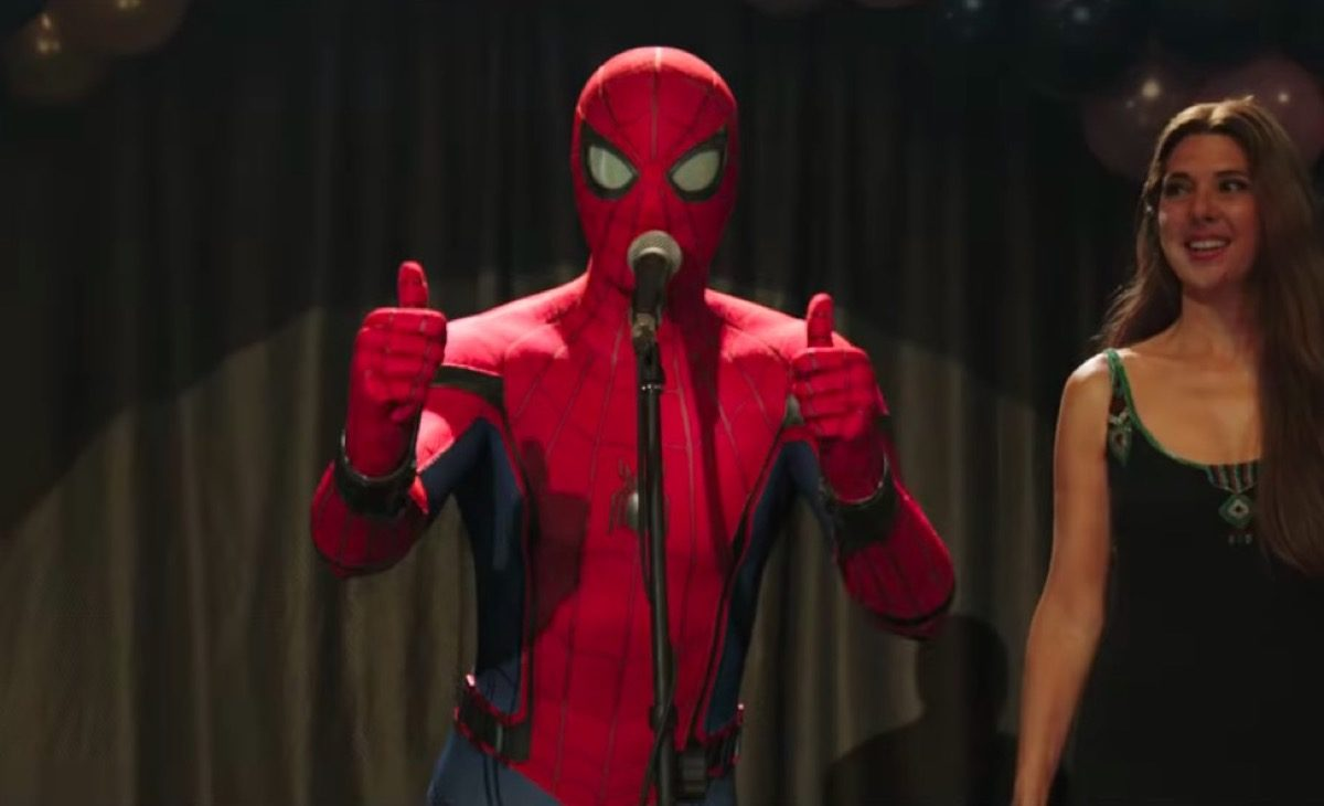 Spider-Man gives double thumbs up onstage in Spider-Man: Far From Home.