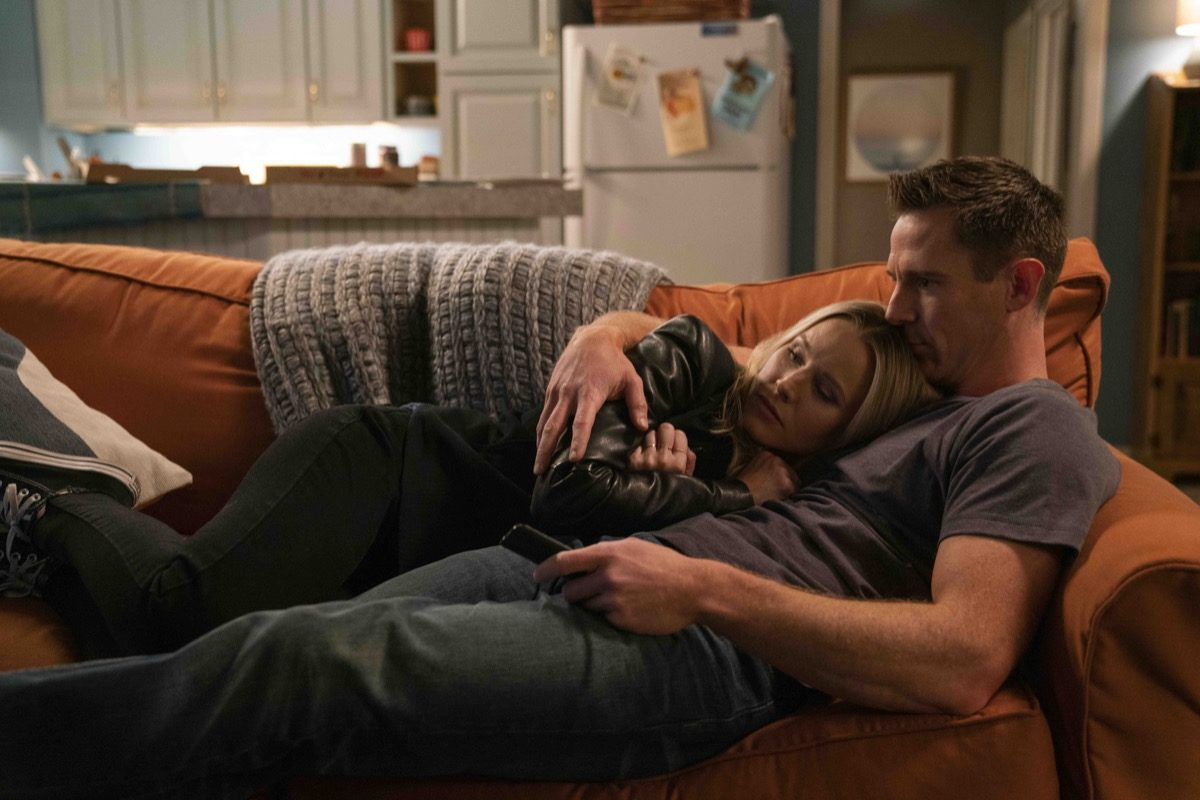 Veronica and Logan snuggle on the couch in Hulu's Veronica Mars.