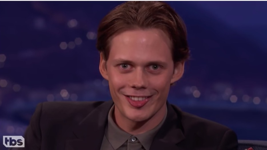Bill Skarsgard does his Pennywise smile.