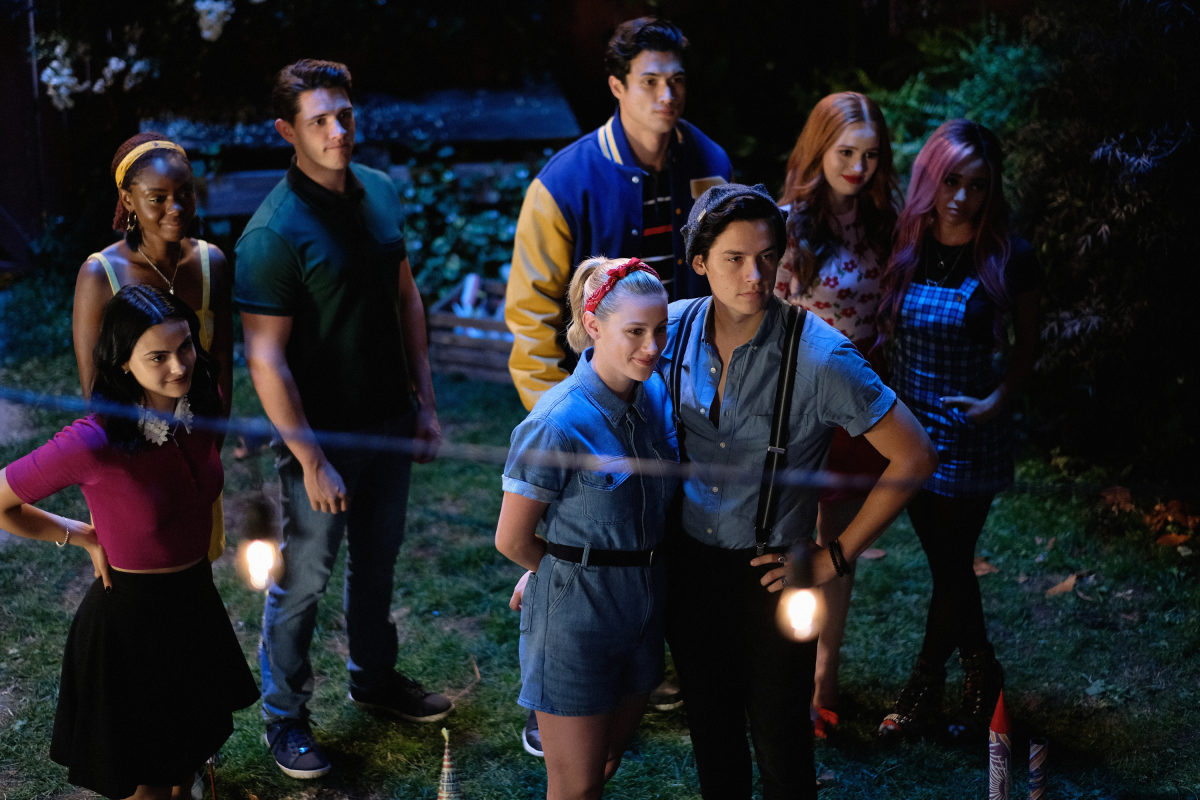 "Riverdale -- ""Chapter Fifty-Eight: In Memoriam"" -- Image Number: RVD401b_0209.jpg -- Pictured (L-R): Camila Mendes as Veronica, Ashleigh Murray as Josie, Casey Cott as Kevin, Charles Melton as Reggie, Lili Reinhart as Betty, Cole Sprouse as Jughead, Madelaine Petsch as Cheryl and Vanessa Morgan as Toni"