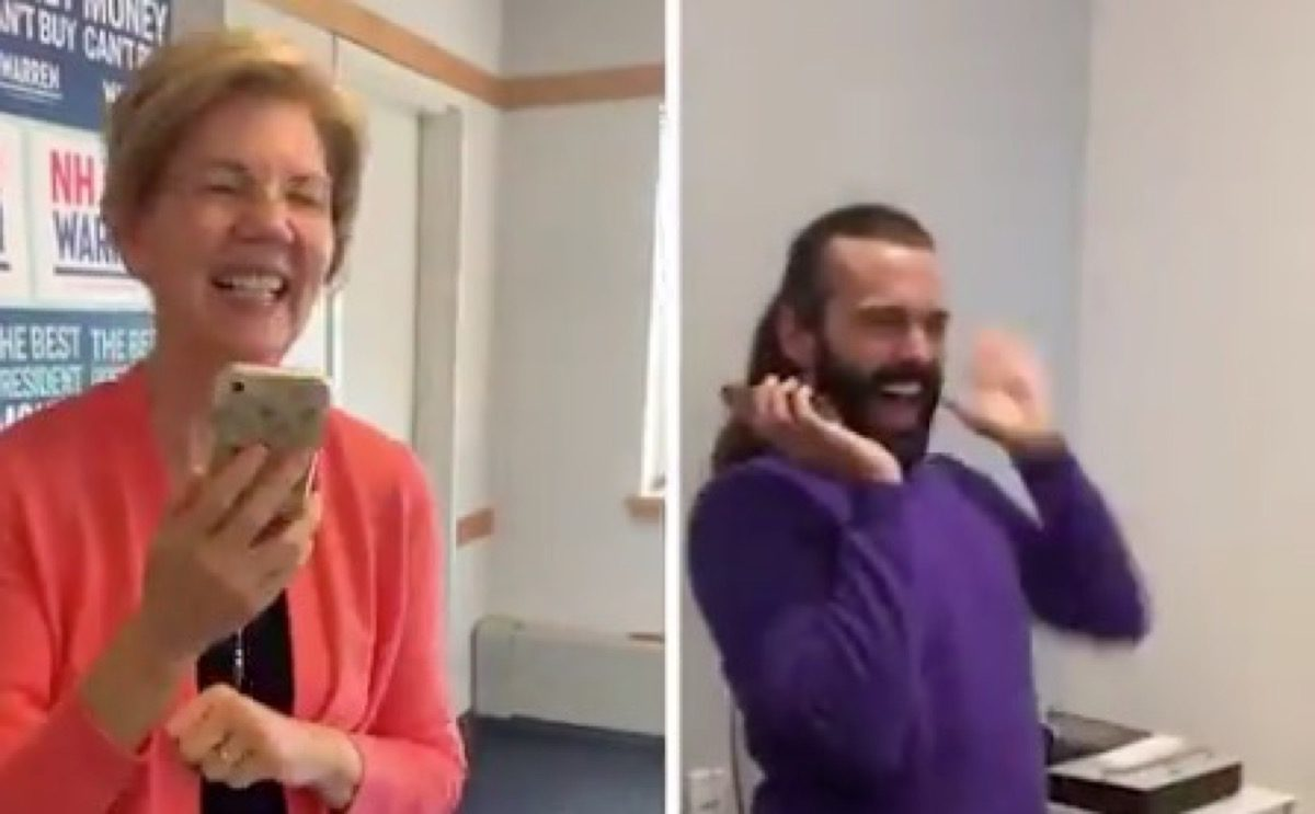 Elizabeth Warren and Jonathan Van Ness talking and laughing.