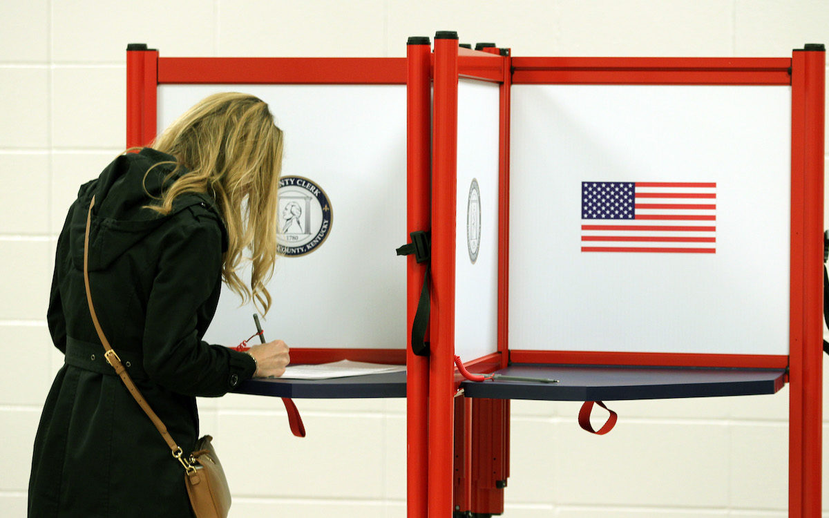 Female voter fills out a ballot on election day.